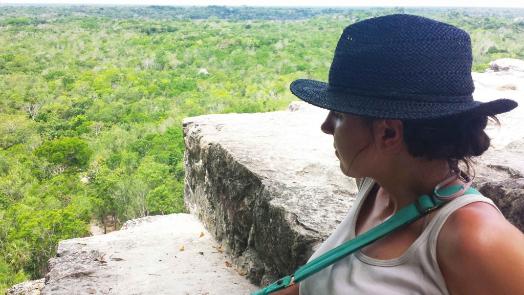 Taking in the view from the top of a mayan pyramid in Mexico
