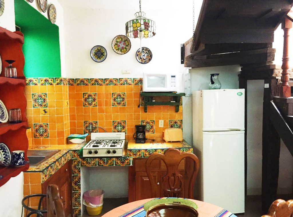 Downstairs Kitchen with refrigerator, stove, sink, pots/pans, dishes, and silverware.