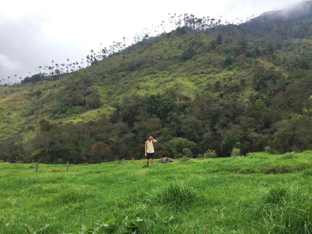 Justin in a field on the Valle de Cocora hike