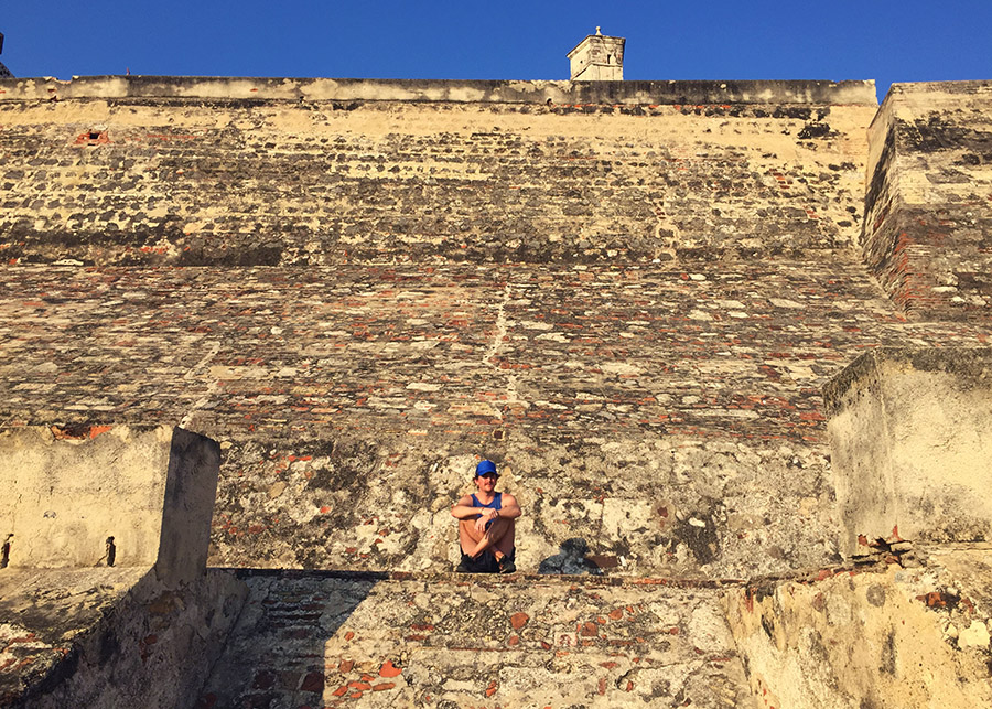 sitting on the Castillo in Cartagena