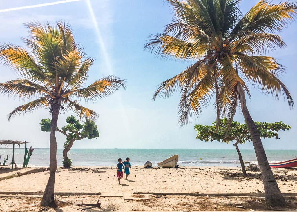 kids on beach in Rincon del Mar, Colombia