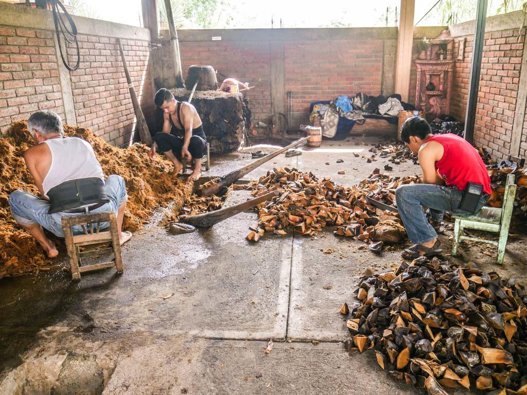 smashing agave by hand oaxaca mezcal