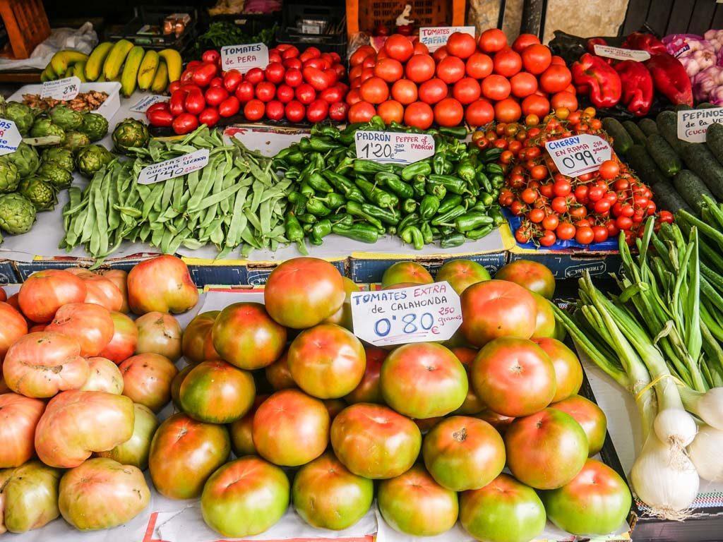 fruit stand spain food sherpas food tour