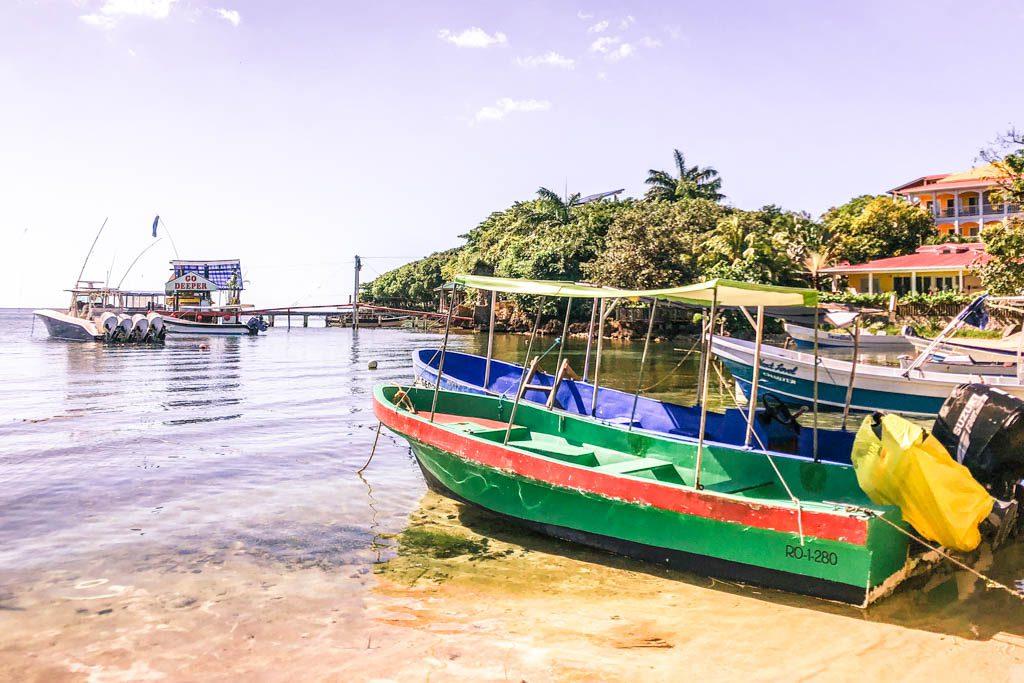 west end beach boats roatan