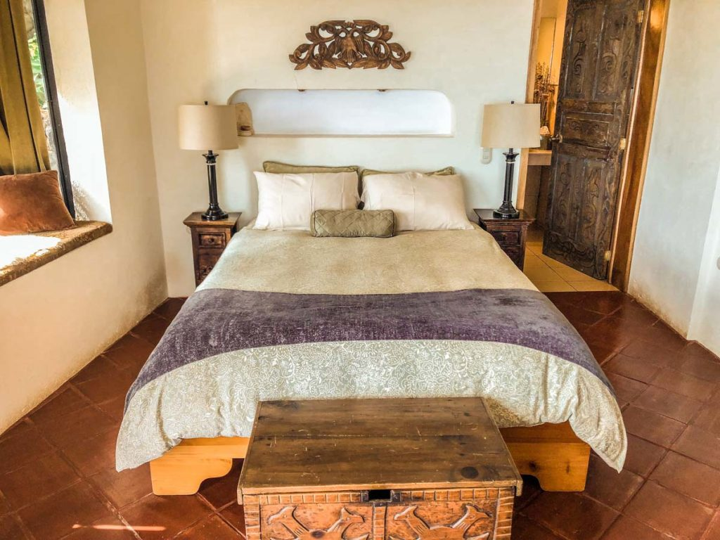 bed in room at lake atitlan retreat
